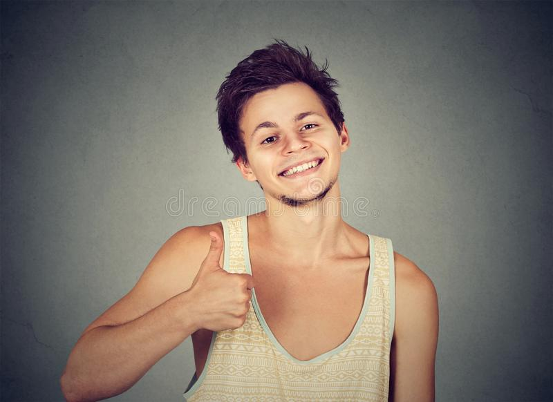 Cool young man showing thumb up royalty free stock photos