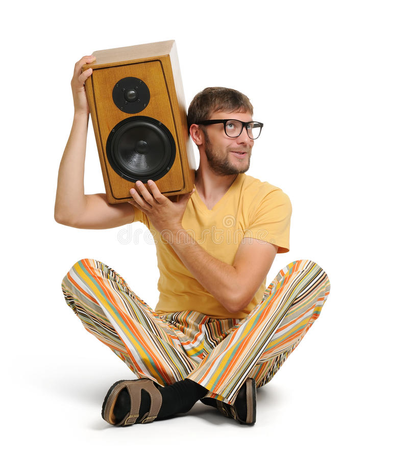 Cool young man with wood speaker stock image