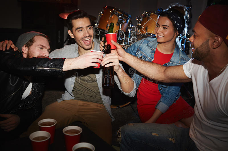 Cool Young People Cheering at Night Club Party royalty free stock photography