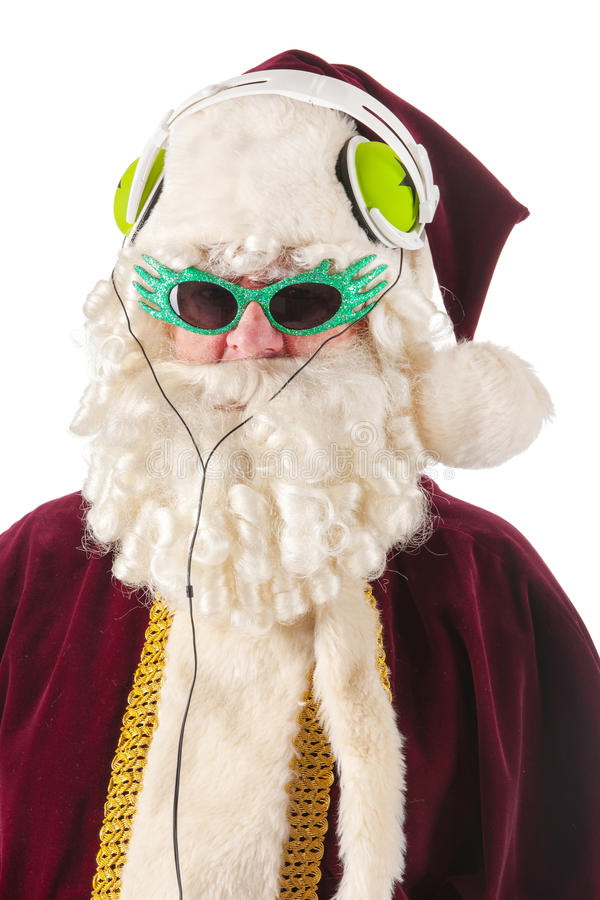 Coole Santa Claus. Portrait of Santa Claus listening to cool music stock photography