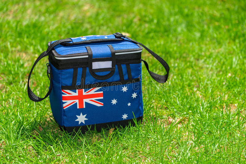 Cooler bag. In Australian Flag colors on the grass royalty free stock images