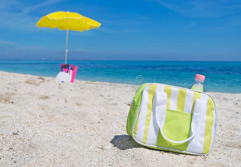 Cooler bag. Green and white cooler bag on the beach royalty free stock photography