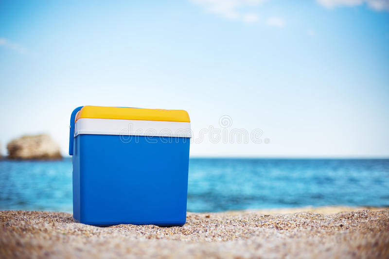 Cooler box on the sand beach. Cooler box on the sea sand royalty free stock photo