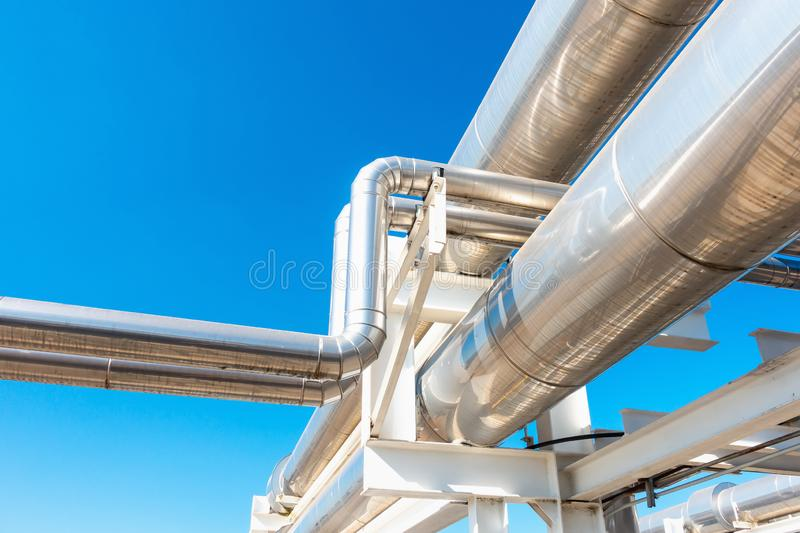 Cooling Chiller or Steam Pipeline and Insulation of Manufacturing in Oil and Gas Industrial, Petrochemical Distribution Pipe at. Refinery Plant. Overhead Steel royalty free stock photo