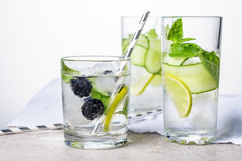 Cooling drink with lime, cucumber, basil and blackberry stock images
