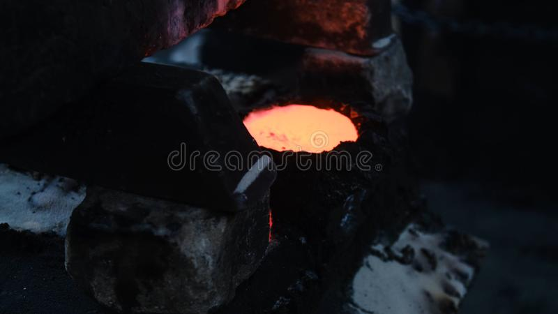 Cooling molten metal. Stock footage. Small container filled with hot metal is designed for cooling and solidification. Metallurgical industry stock photo