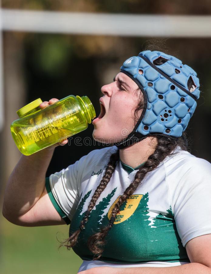 Cooling Off. Female rugby action in Redding, California royalty free stock photo