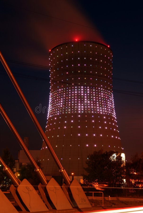Cooling tower. Beautifully lit cooling tower at night royalty free stock photos