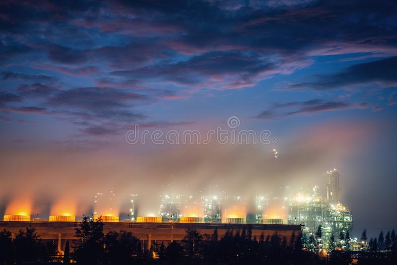 Cooling Tower of Oil and Gas Refinery Plant at Sunset. Process Buildings of Petrochemical Manufacturing., Business Engineering and. Power Energy, Chemical and stock photography