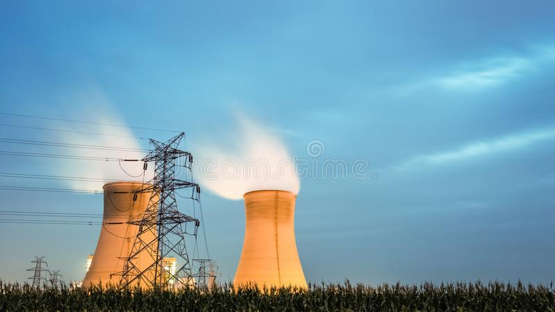 Cooling tower of power plant in nightfall. Modern energy and carbon emission concept stock photography