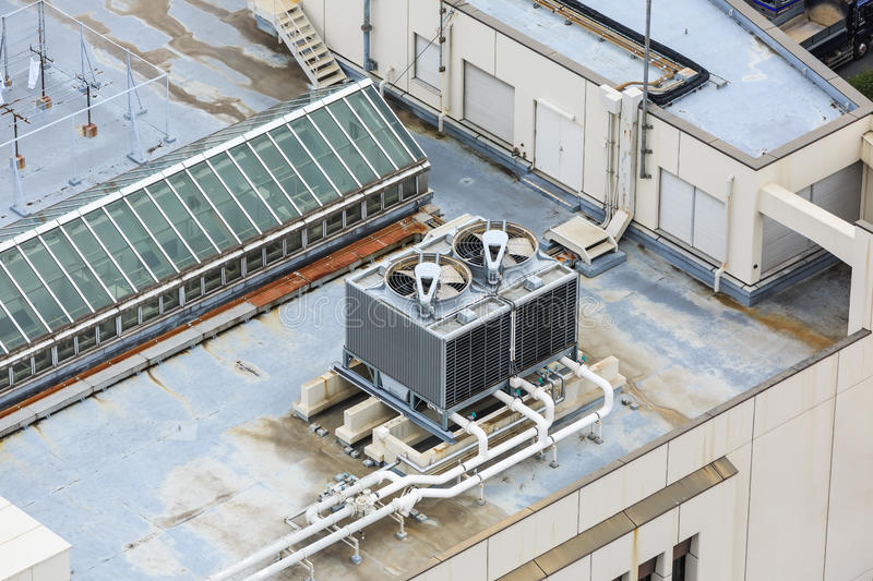 Cooling tower on rooftop royalty free stock photo