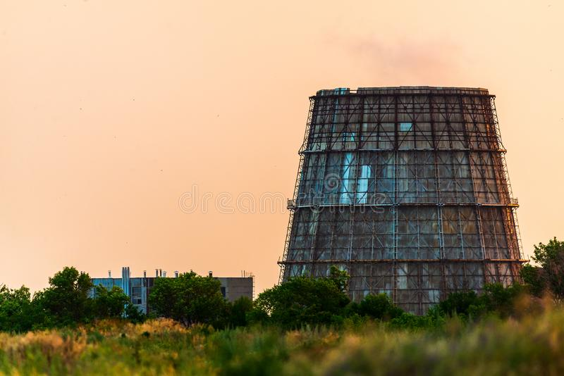 Cooling tower of thermal power plant. Power supply industry, nuclear, pollution, electricity, energy, production, smoke, steam, technology, atmosphere, atomic royalty free stock images