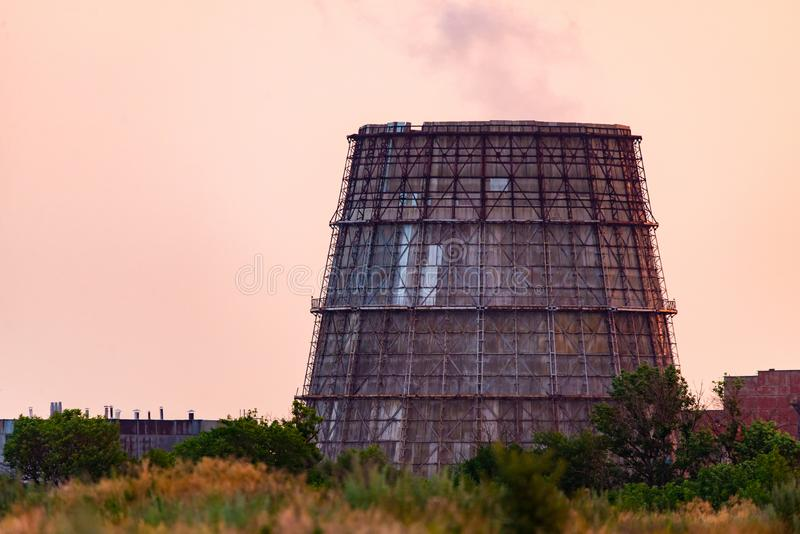 Cooling tower of thermal power plant. Power supply industry, nuclear, pollution, electricity, energy, production, smoke, steam, technology, atmosphere, atomic royalty free stock photography