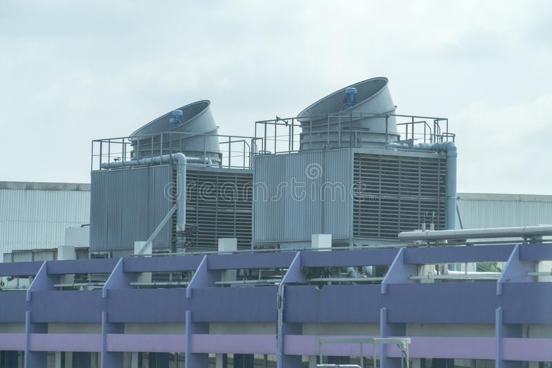 Cooling towers on daylight on the purple floor.  stock photography