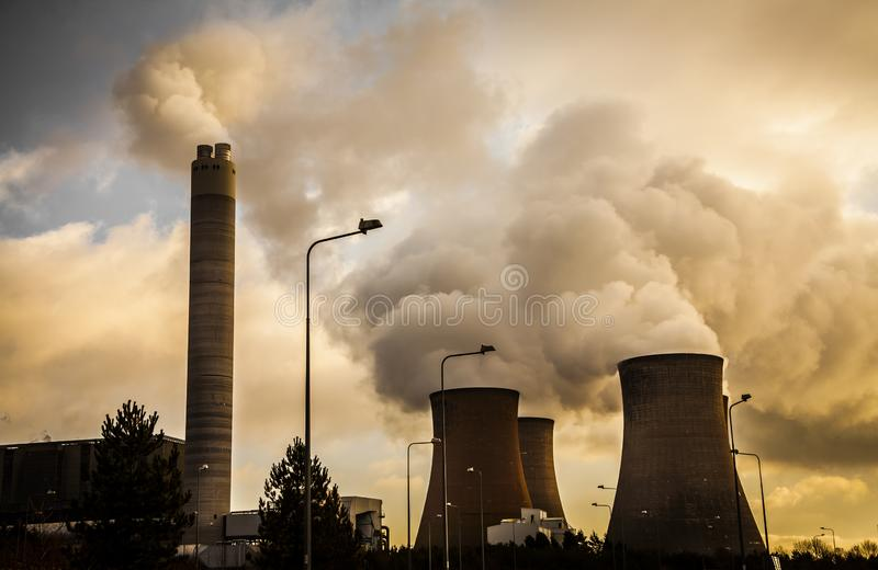 Cooling towers factory industrial spewing pollution and water vapour. Cooling towers power station factory industrial spewing pollution and water vapour at stock photo