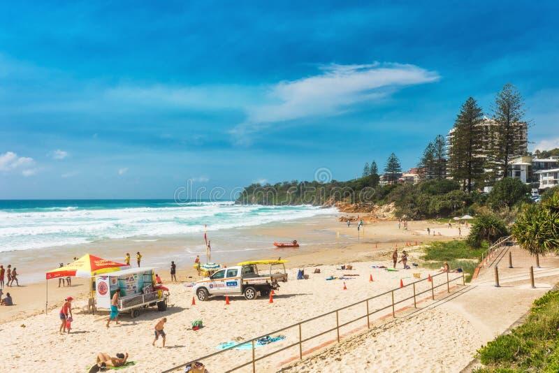 COOLUM, AUSTRALIA, FEB 18 2018: People enjoying summer at Coolum main beach - a famous tourist destination in Australia. COOLUM, AUSTRALIA, FEB 18 2018: People stock photos