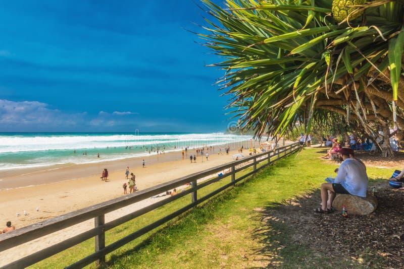COOLUM, AUSTRALIA, FEB 18 2018: People enjoying summer at Coolum main beach - tourist destination in Queensland, Australia. COOLUM, AUSTRALIA, FEB 18 2018 royalty free stock photos
