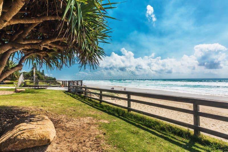 COOLUM, AUSTRALIA, FEB 18 2018: People enjoying summer at Coolum main beach - famous tourist destination in Queensland, Australia. COOLUM, AUSTRALIA, FEB 18 stock photo