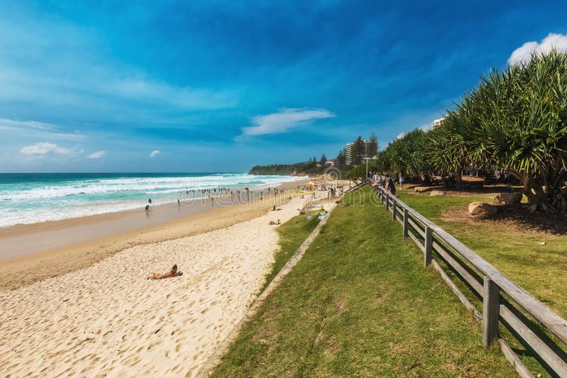 COOLUM, AUSTRALIA, FEB 18 2018: People enjoying summer at Coolum main beach - a famous tourist destination in Queensland, Austral. Ia royalty free stock photos