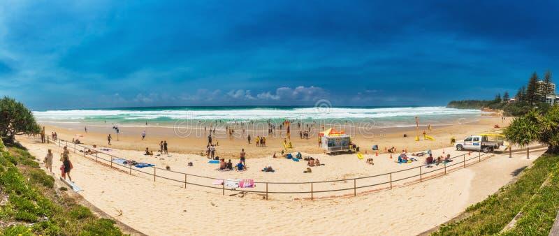 COOLUM, AUSTRALIA, FEB 18 2018: People enjoying summer at Coolum main beach - a famous tourist destination, Queensland, Australia. COOLUM, AUSTRALIA, FEB 18 royalty free stock photo
