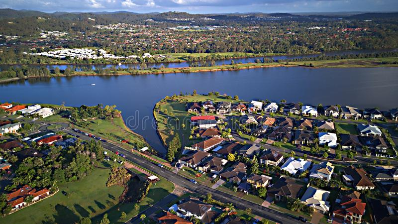 On The lake Regatta Waters Parkland Gold Coast Grass play area House Estate next to Coomera River Hope Island,. Coomera River Hope Island Parkland Gold Coast stock photo