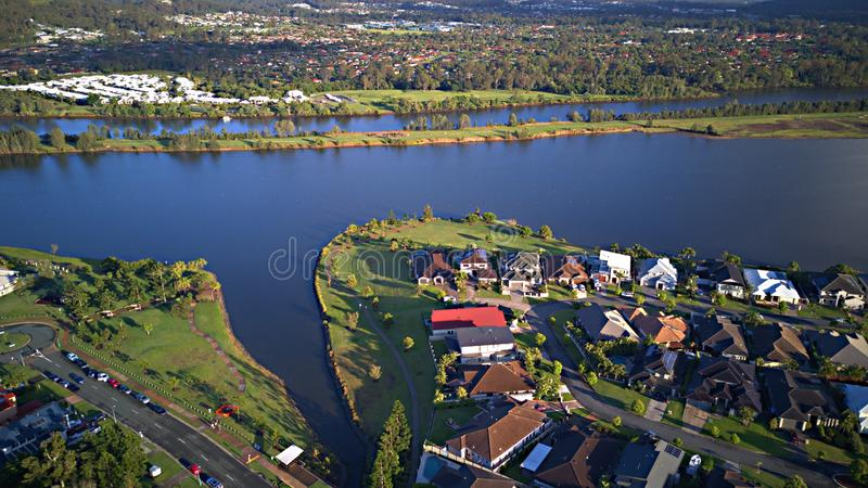 Morning view Regatta Waters On The lake and Parkland Gold Coast Grass play area House Estate next to Coomera River On The lake,. Coomera River Hope Island stock image
