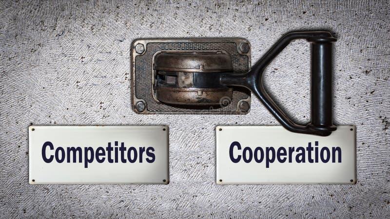Coopération de commutateur de mur contre des concurrents image libre de droits
