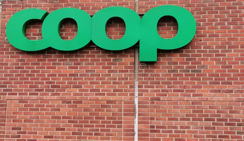 Coop sign on brick wall royalty free stock image