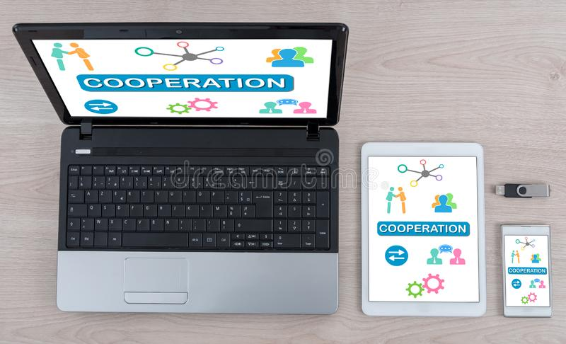 Cooperation concept on different devices. Cooperation concept shown on different information technology devices royalty free stock image