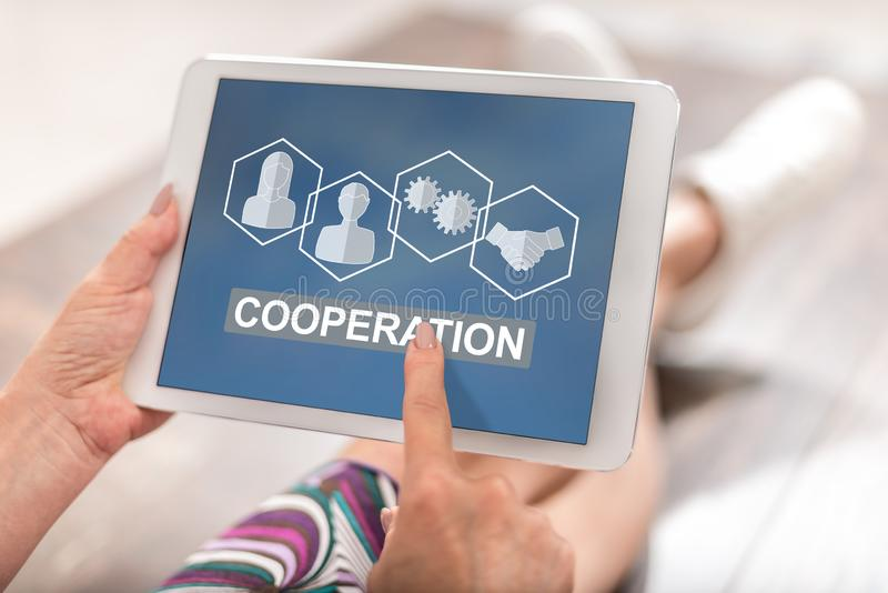 Cooperation concept on a tablet royalty free stock photos