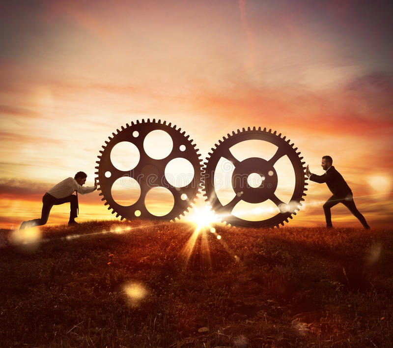 Cooperation at work concept with gears mechanism stock photography