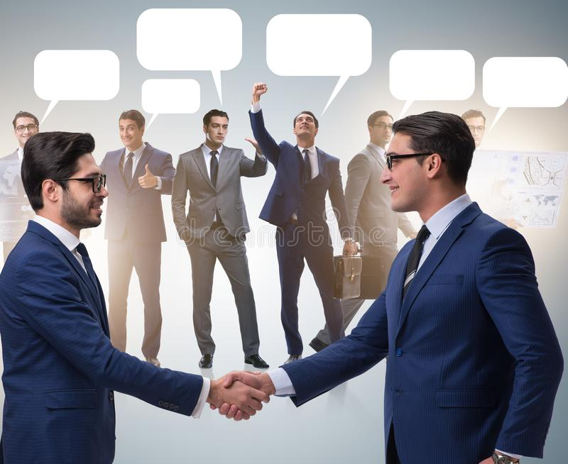 Cooperationa and teamwork concept with handshake stock images