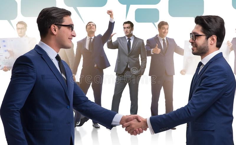 Cooperationa and teamwork concept with handshake stock image