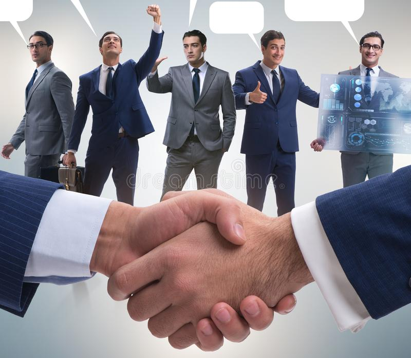 Cooperationa and teamwork concept with handshake stock photography