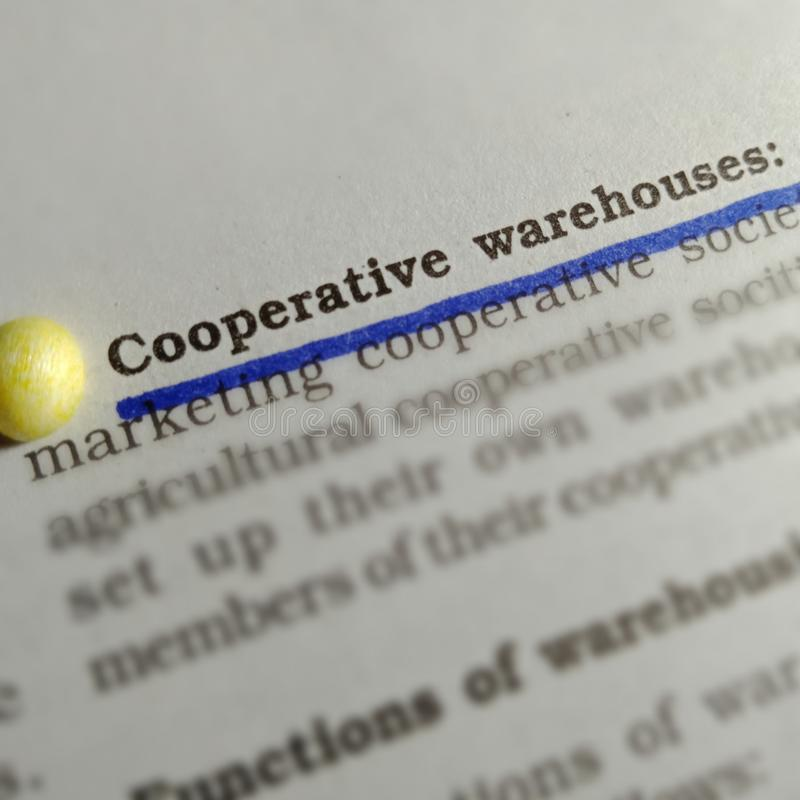 Cooperative warehouses text underlined with blue color at book article stock image