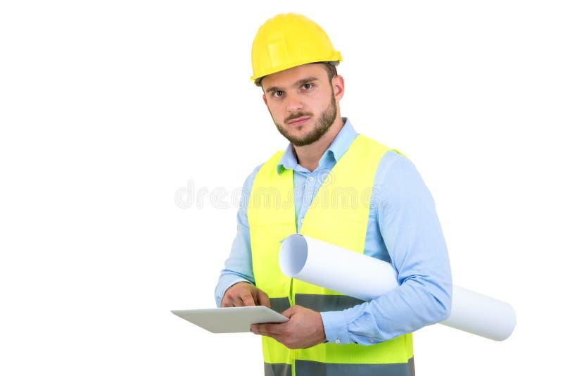 Coordenador considerável que trabalha com um PC da tabuleta, isolado no branco imagem de stock royalty free