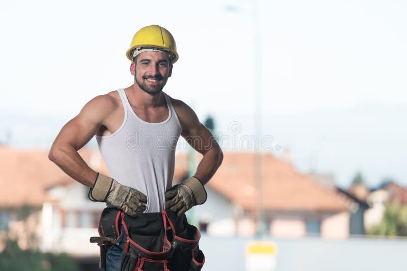Coordenador Construction Wearing um capacete amarelo imagem de stock royalty free