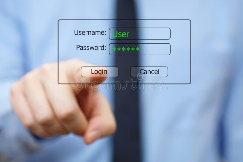 Coordenador de sistema que empurra o botão do fazer logon na exposição virtual fotos de stock royalty free