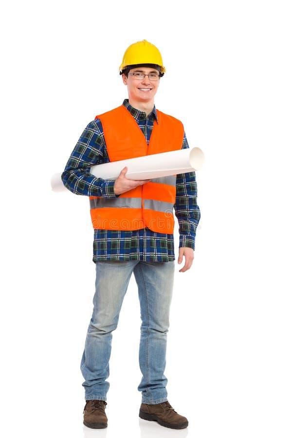 Coordenador de sorriso que guarda o rolo de papel. foto de stock royalty free