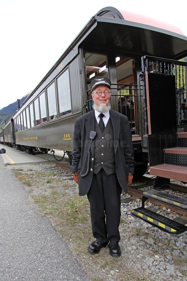 Coordenador e o seu trem imagens de stock