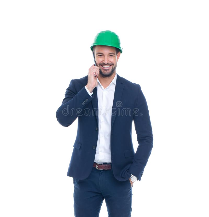 Coordenador feliz no vestuário formal e capacete que chamam isolado fotos de stock
