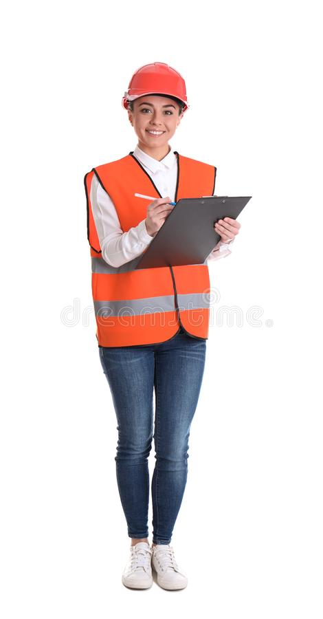 Coordenador industrial fêmea no uniforme com a prancheta no fundo branco imagens de stock