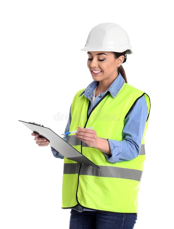 Coordenador industrial fêmea no uniforme com a prancheta no fundo branco imagem de stock