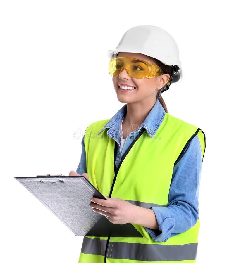 Coordenador industrial fêmea no uniforme com a prancheta no fundo branco foto de stock