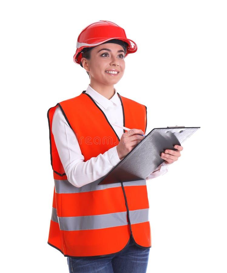 Coordenador industrial fêmea no uniforme com a prancheta no fundo branco imagem de stock royalty free