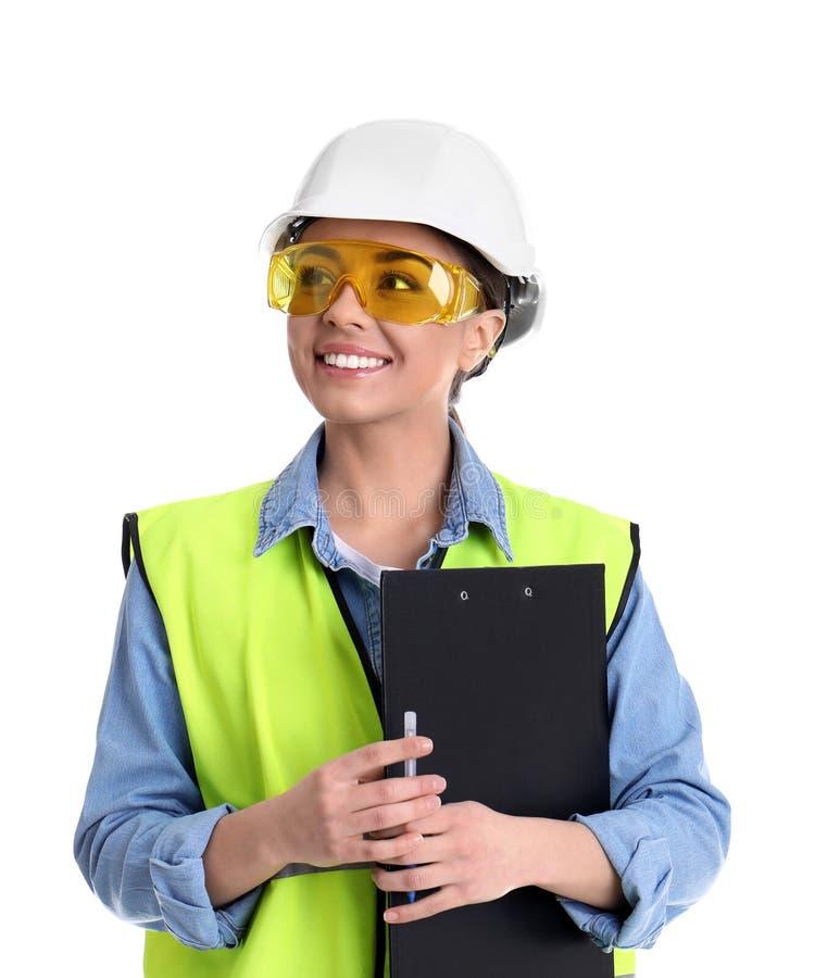 Coordenador industrial fêmea no uniforme com a prancheta no fundo branco imagens de stock royalty free