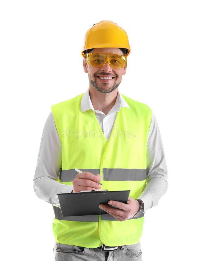 Coordenador industrial masculino no uniforme com a prancheta no branco foto de stock
