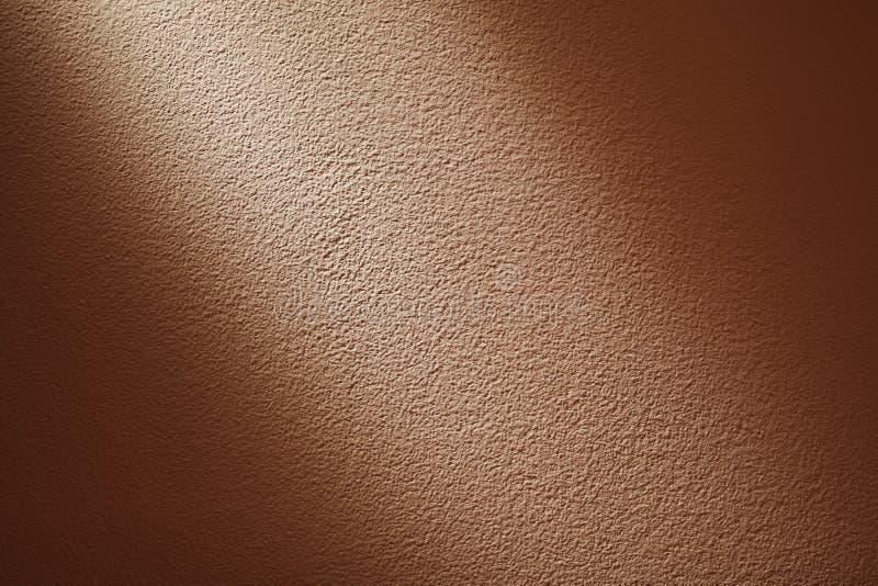 Coordonnées de Pale Orange Wall Partly Illuminated photo libre de droits