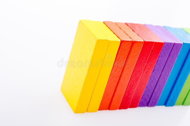 Coorful domino blocks on white background. Colorful Domino Blocks in a line on a white background stock photo
