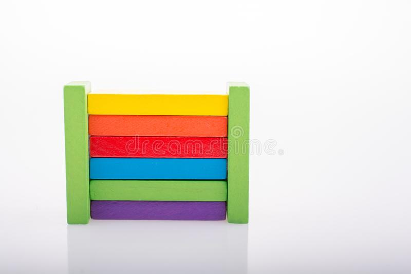 Coorful domino blocks on white background. Colorful Domino Blocks in a line on a white background stock photography